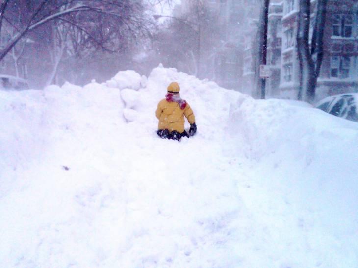 Kid Enjoying Chicago Blizzard 2011